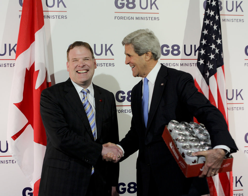 Secretary Kerry and Canadian Foreign Minister John Baird Shake Hands Over Fulfillment of Hockey Match Bet