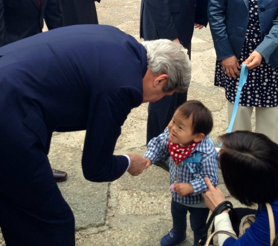 Secretary Kerry Meets a Child at Zojoji Shrine
