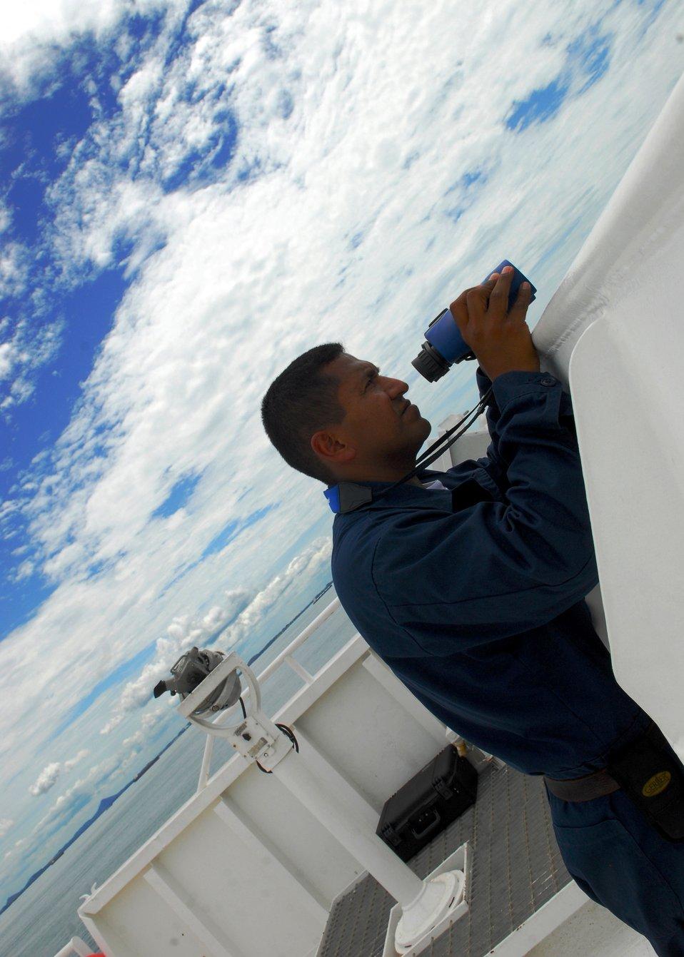 Ordinary Seaman Catalan Looks Through Binoculars