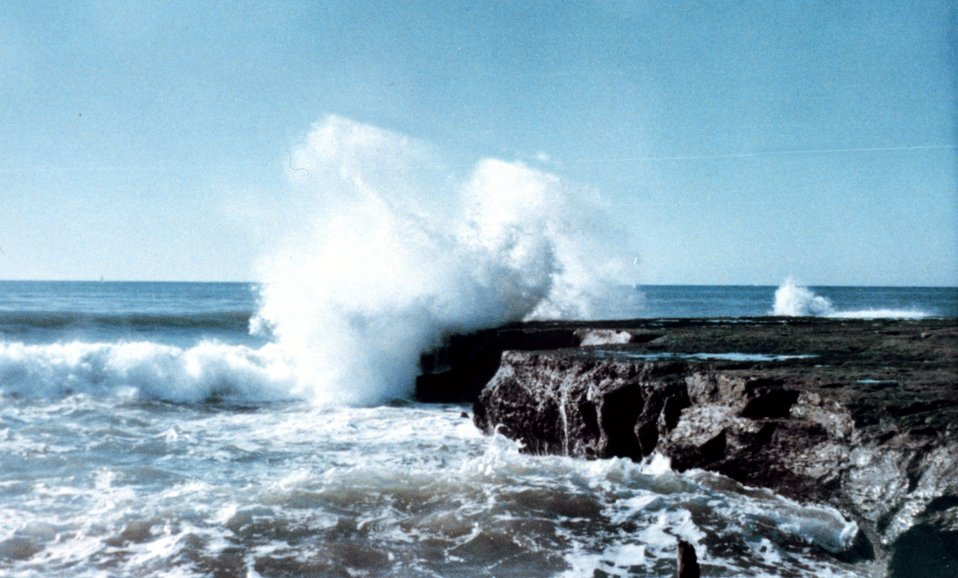 Surf encountering a rocky headland at Soquel Point.