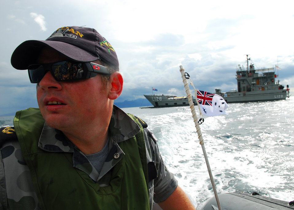 Australian Royal Navy Leading Seaman Nathan Byast Drives a Rigid Hull Inflatable Boat