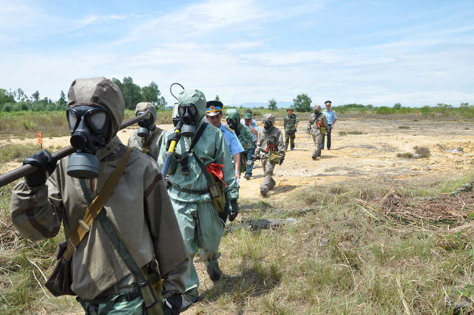 Vietnamese soldiers demonstrate UXO detection and clearance in Danang. June 17, 2011