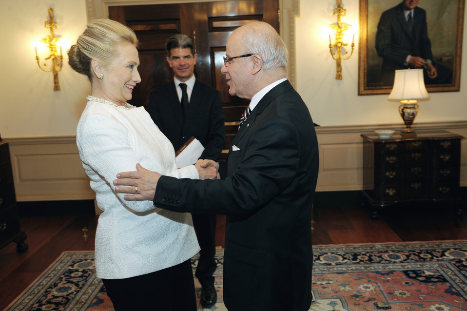 Secretary Clinton Shakes Hands With Algerian Foreign Minister Medelci