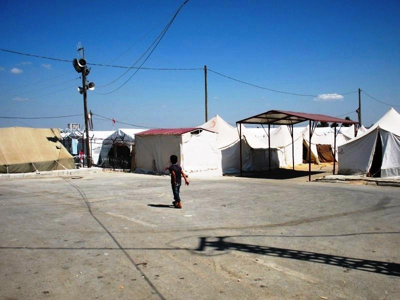 A Syrian Boy Walks at a Camp in Turkey