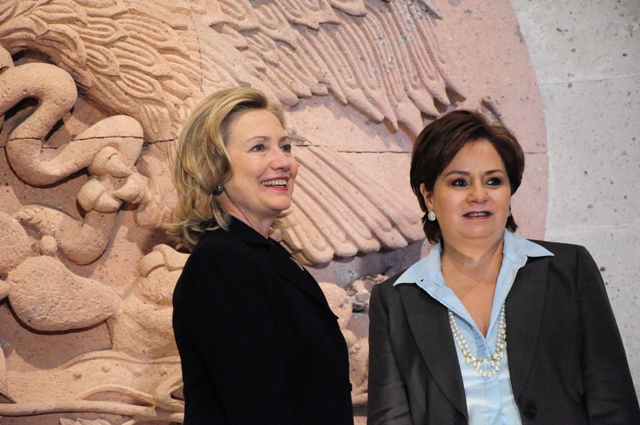 Secretary Clinton and Mexican Foreign Secretary Espinosa Stand Before the Perpetual Flame