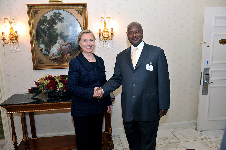 Secretary Clinton Shakes Hands With Ugandan President Museveni