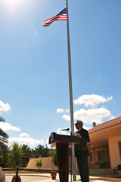 Ambassador Cretz Stands at the Podium