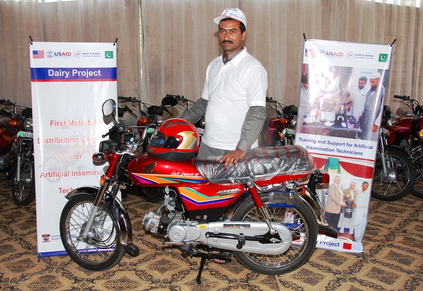 A successfull AI technician with his new motorcycle awarded by USAID Dairy Project 2