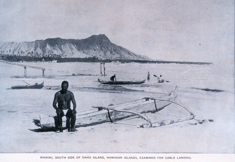 Native Hawaiian sitting on outrigger canoe with Diamondhead in the background. 'Coral Reefs of the Hawaiian Islands' by Alexander Agassiz.  April 1889. Bulletin of the Museum of Comparative Zoology, at Harvard College.  Vol. XVII. No. 3.  Library Call