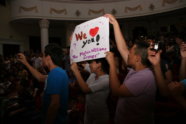 : Fans Hold Up Posters During the Melvin Williams Group's Concert
