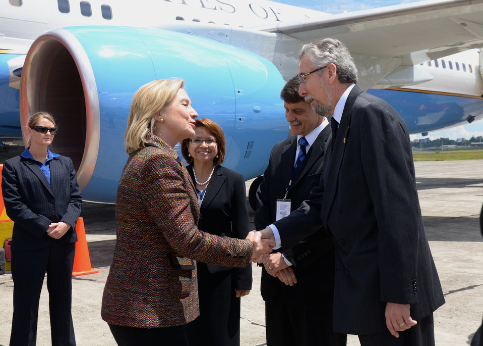 Secretary Clinton Is Greeted By Guatemalan Ambassador to the U.S. Villagran and Ambassador McFarland