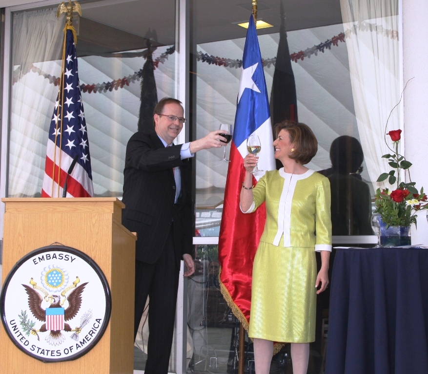Ambassador Simons and His Wife Victoria Cardenas Simons Toast to the Fourth of July