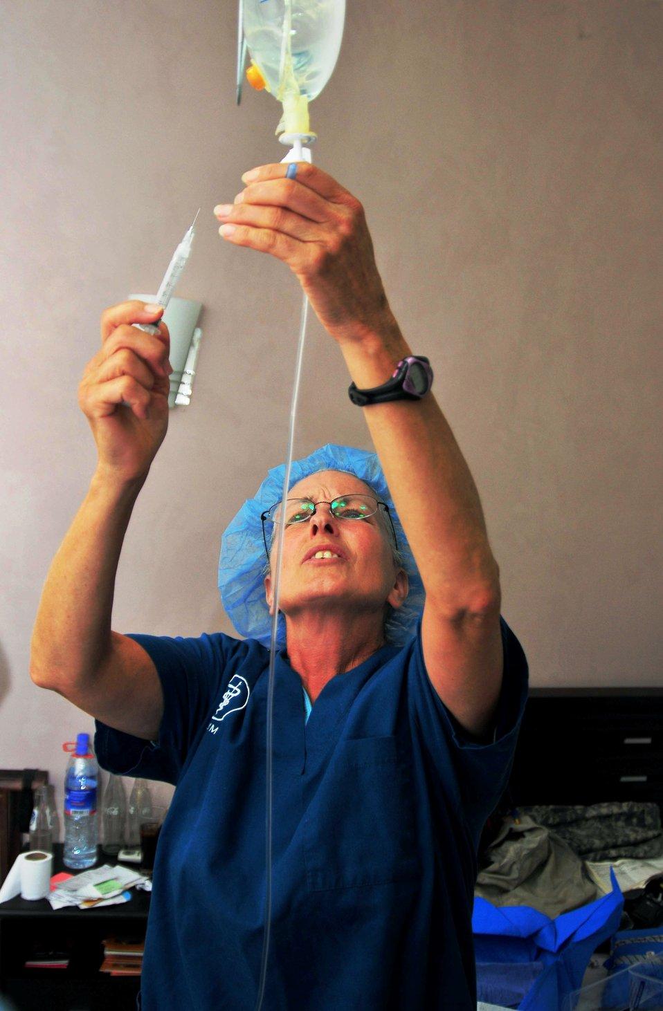 Vets Without Borders Veterinarian Dr. Louis Castalenelli Prepares an Intravenous Fluid Bag