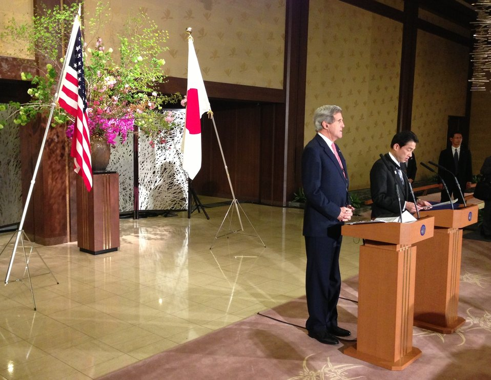 Secretary Kerry Listens as Japanese Foreign Minister Fumio Kishida Addresses News Conference