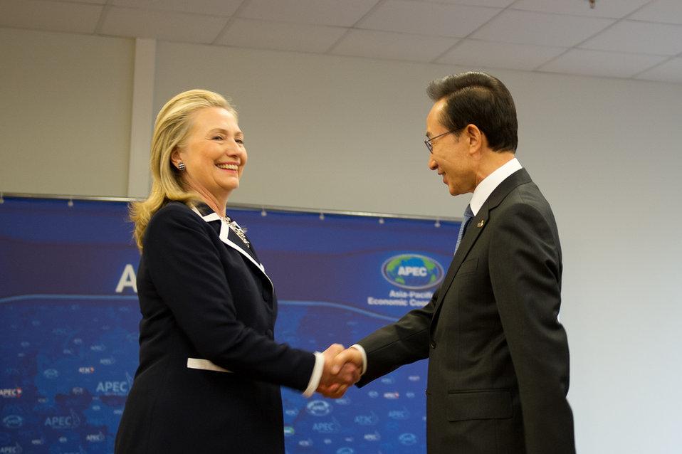 Secretary Clinton Shakes Hands With South Korean President Lee