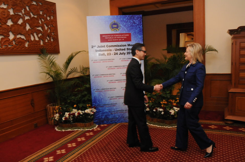 Secretary Clinton Is Greeted By Indonesian Foreign Minister Natalegawa
