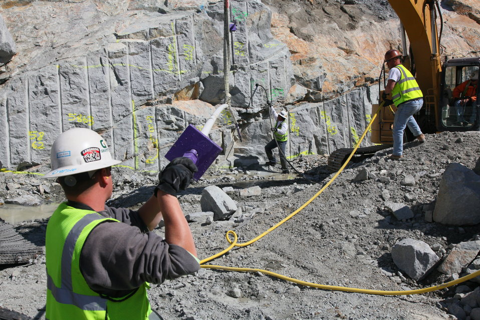 Installing rock securing bolts at the Folsom Dam auxiliary spillway