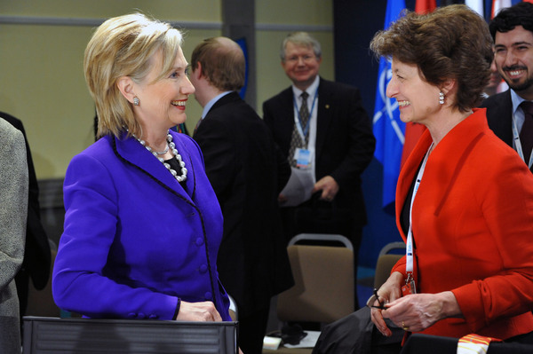 Secretary Clinton Speaks With Deputy Director Claude-Rance Arnould