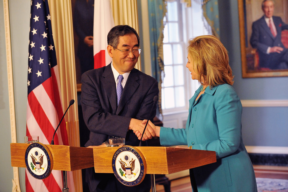 Secretary Clinton Shakes Hands With Japanese Foreign Minister Matsumoto