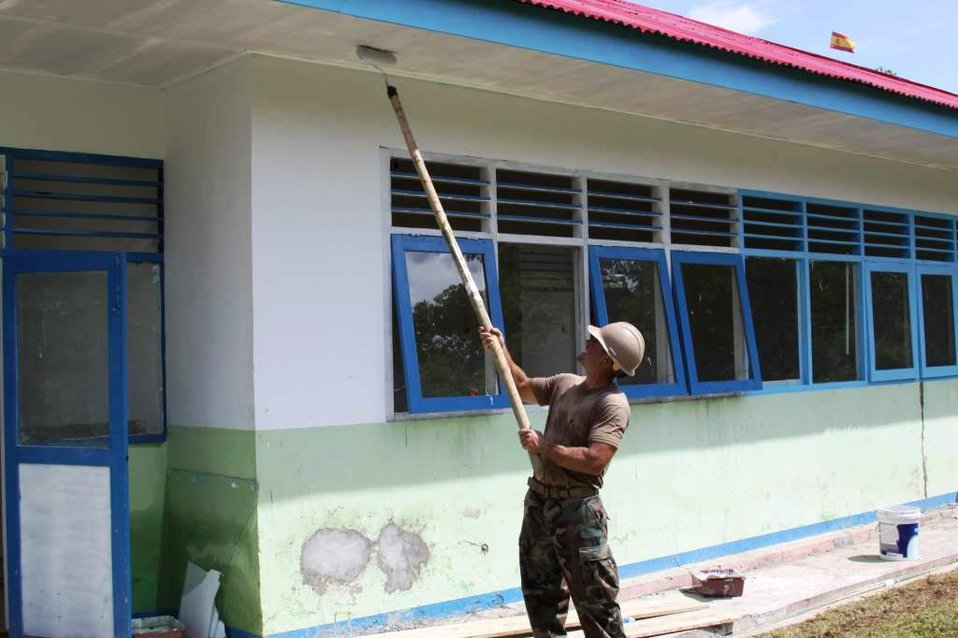 Utilitiesman 2nd Class Jacob Simino Paints the Exterior of the In-Patient Ward of the Daruba Hospital Engineering Site