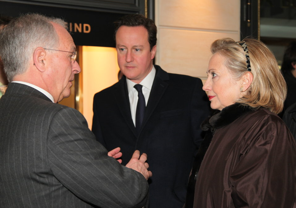 Secretary Clinton and British Prime Minister Cameron Are Welcomed to the Munich Conference By German Diplomat Ischinger