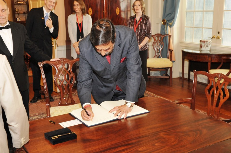 Indian Commerce Minister Sharma Signs the Guest Book
