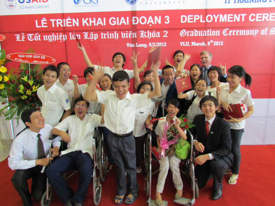 Graduates receive certificates in IT from a USAID-funded training program at Van Lang University, HCMC