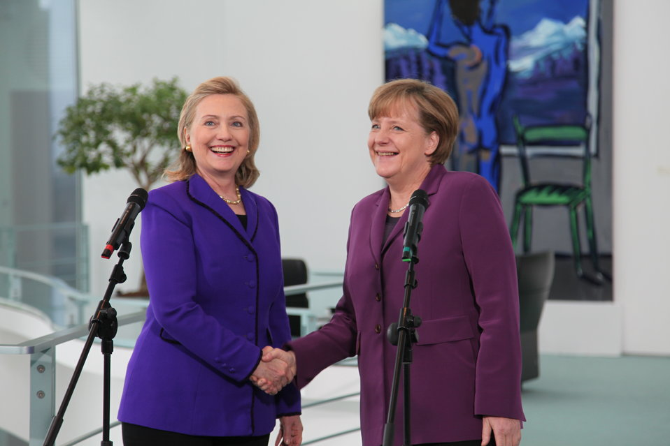 Secretary Clinton Is Welcomed By German Chancellor Merkel