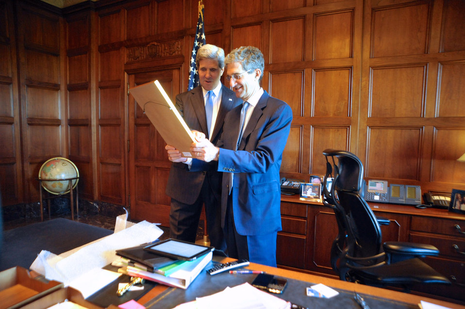Secretary John Kerry Presents His Brother, Acting Commerce Secretary Cameron Kerry, a Framed Copy of a Joint Cable They Sent