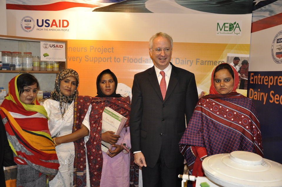 Ambassador Cameron Munter with the Dairy project beneficiaries at the Entrepreneurs project stall