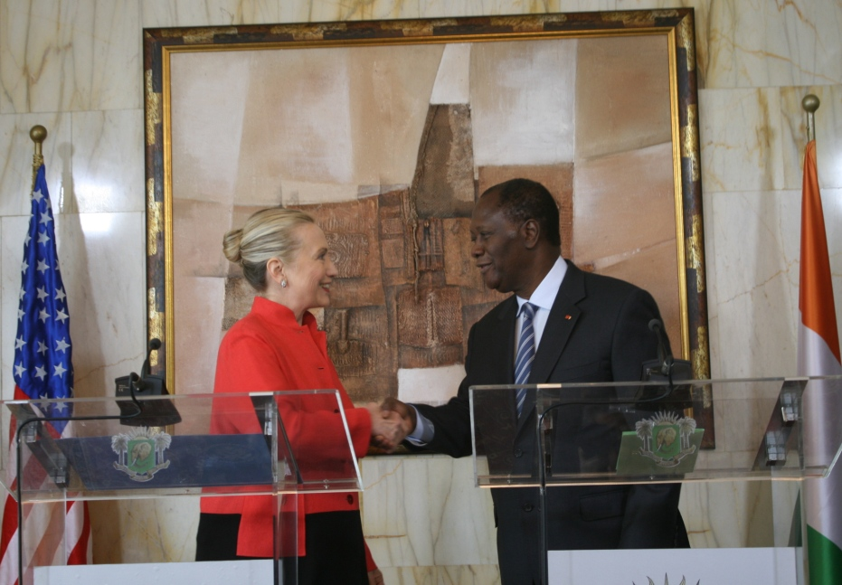 Secretary Clinton Shakes Hands With Ivoirian President Ouattara