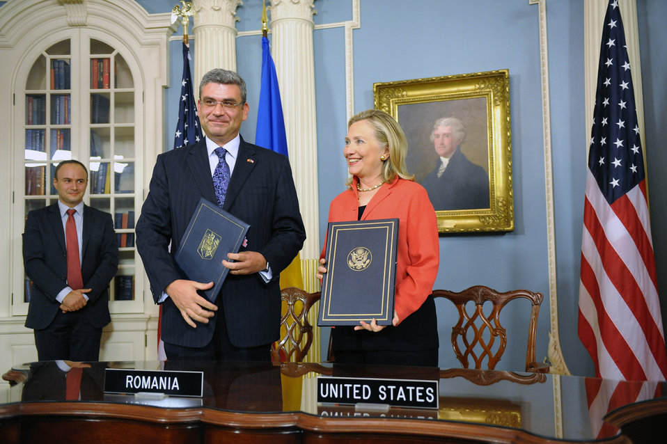 Secretary Clinton and Romanian Foreign Minister Baconschi Pose for a Photo