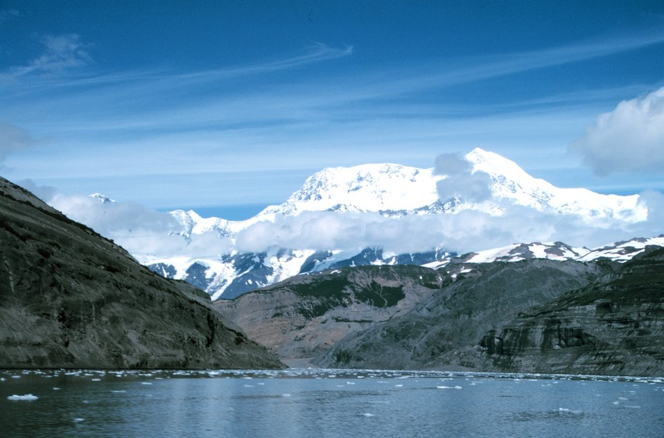 Photo #9 of Mount St. Elias sequence. Mount Saint Elias is one of the largest mountains visible from the sea on the North American continent.  It rises to a height of 18,008 feet in a distance of less than 20 miles from sea level at Icy Bay.