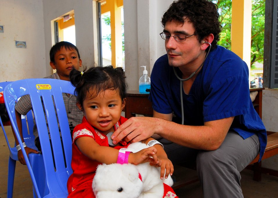 New Zealand Medical Student Philip Drennen Listens to a Child's Heartbeat