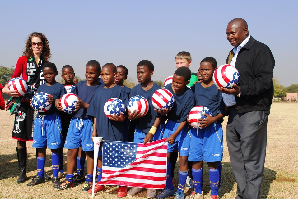 U-11 Bafokeng Football Academy Teams Playing for the U.S. Poses for a Photo With Press Attache Hudson-Dean