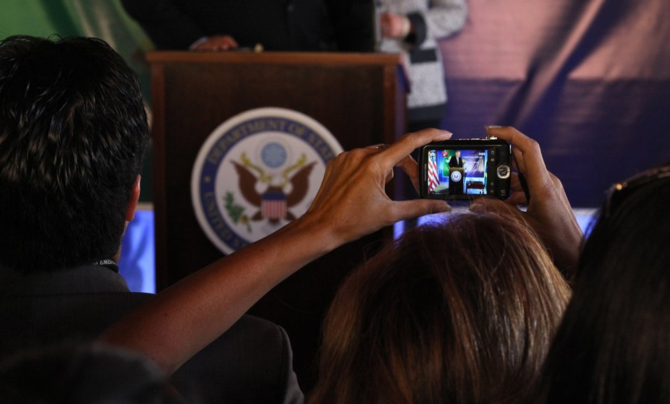 Embassy Brasilia Staff Member Takes a Photo of Secretary Clinton