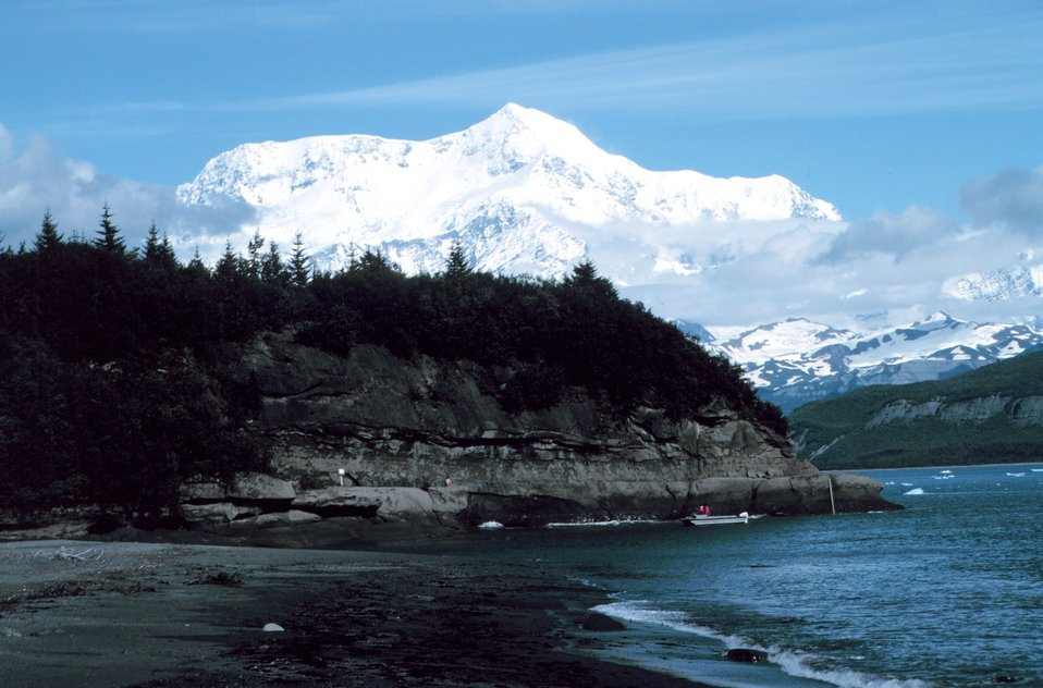 Photo #7 of Mount St. Elias sequence. Mount Saint Elias is one of the largest mountains visible from the sea on the North American continent.  It rises to a height of 18,008 feet in a distance of less than 20 miles from sea level at Icy Bay.