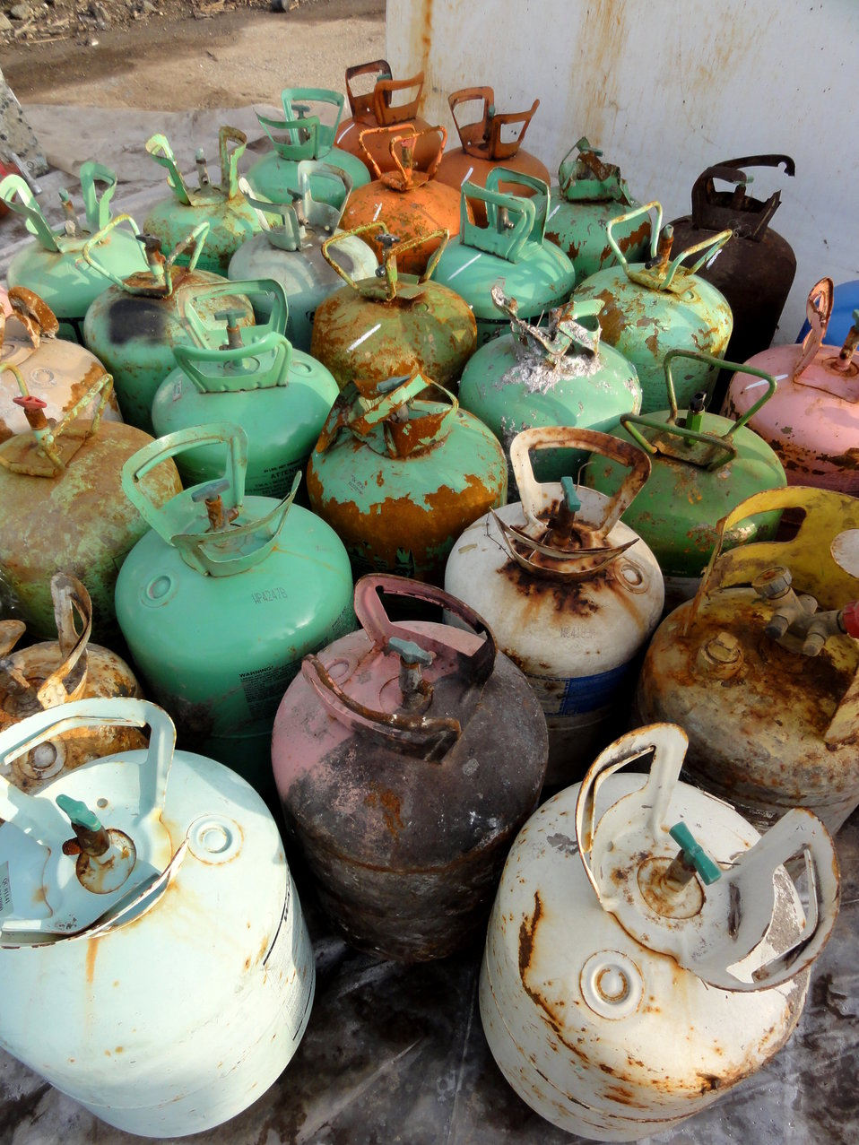 December 2, 2012 - Colorful Freon tanks, ready for recycling.