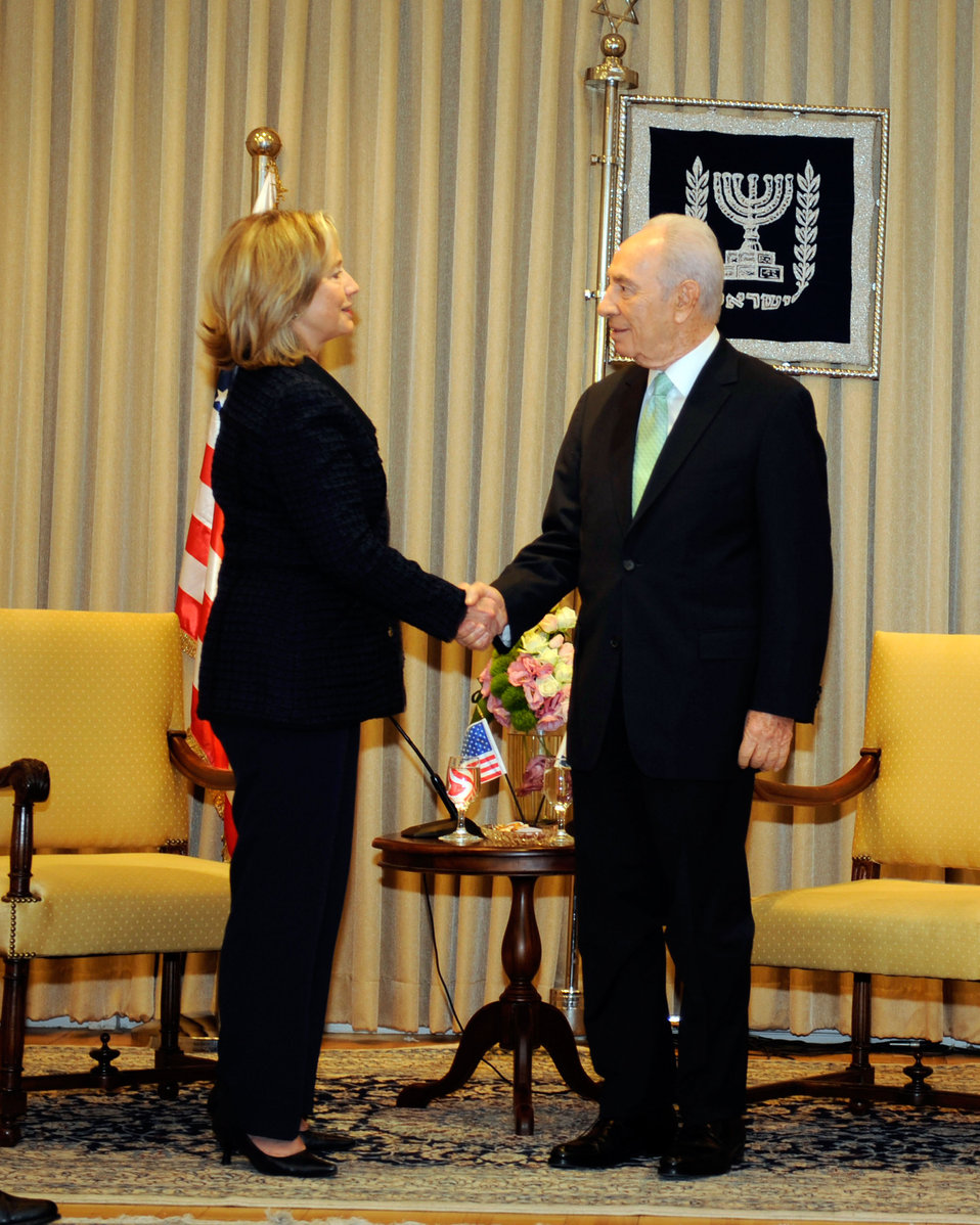 Israeli President Peres Shakes Hands With Secretary Clinton