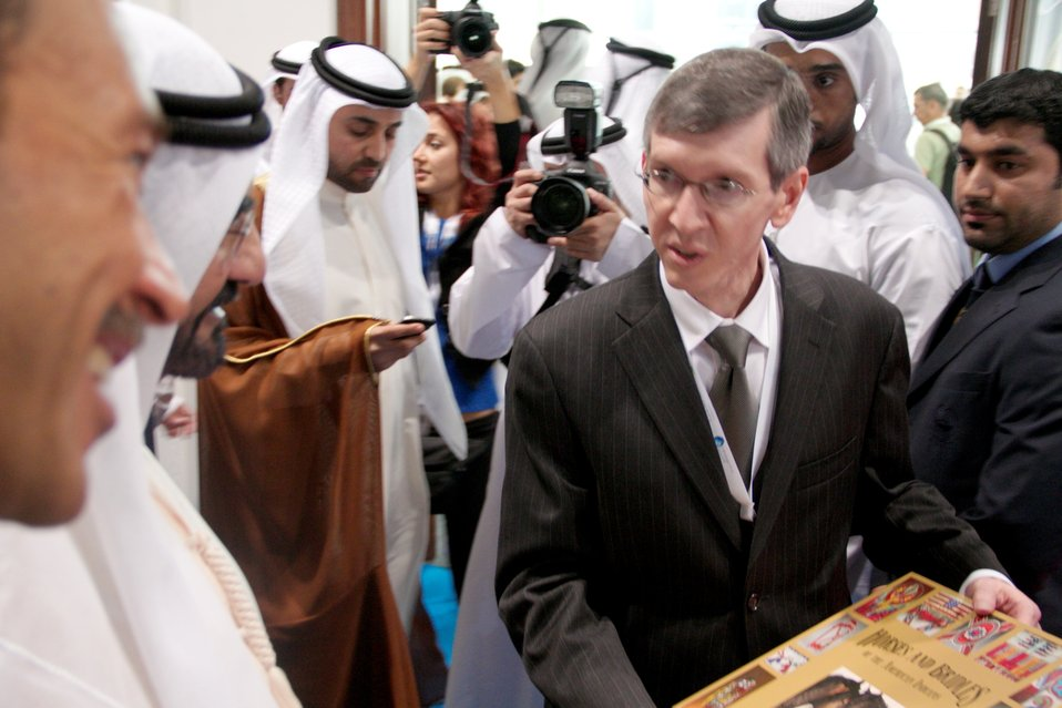 Consul General Waller Presents a Book to the Ruler of Dubai