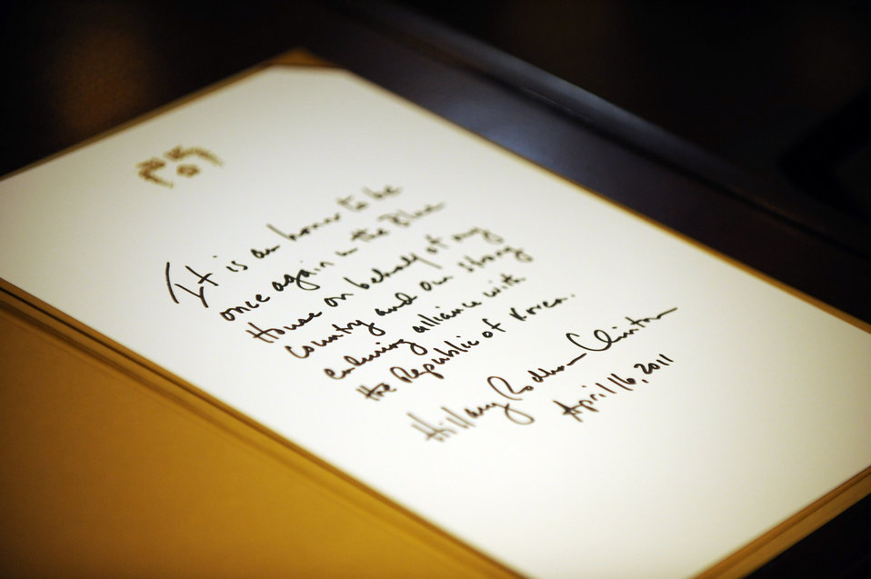 Secretary Clinton's Note in the Guest Book Is Photographed