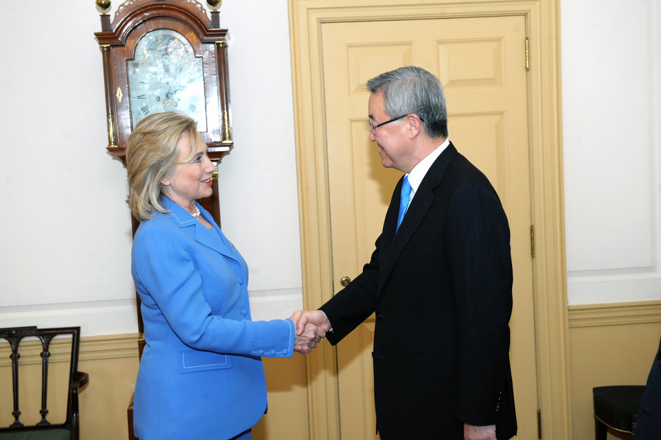 Secretary Clinton Shakes Hands With Korean Foreign Minister Kim Sung-Hwan