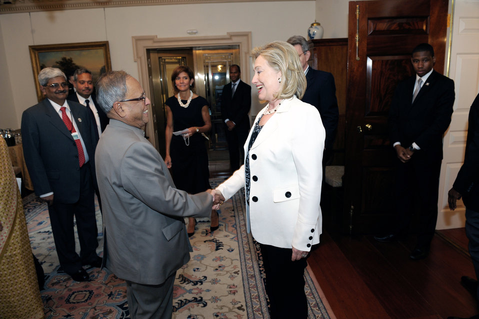 Secretary Clinton Shakes Hands With Indian Finance Minister Mukherjee