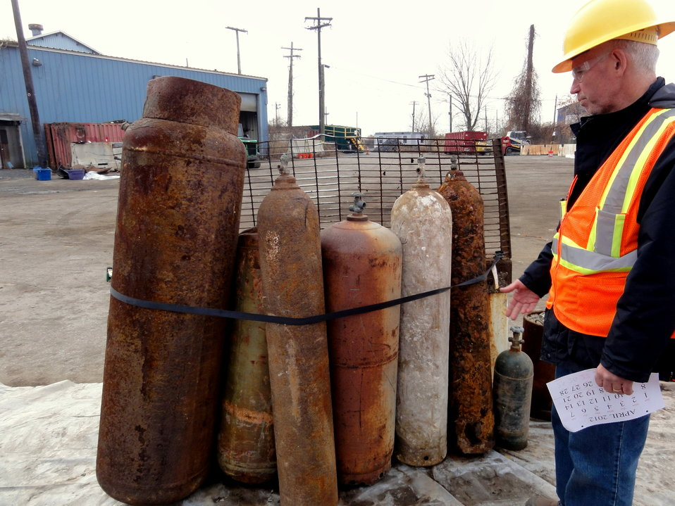 December 2, 2012 - EPA On-Scene Coordinator Michael Ferriola points out 'mystery tanks' at the Fresh Kills, Staten Island Collection Area