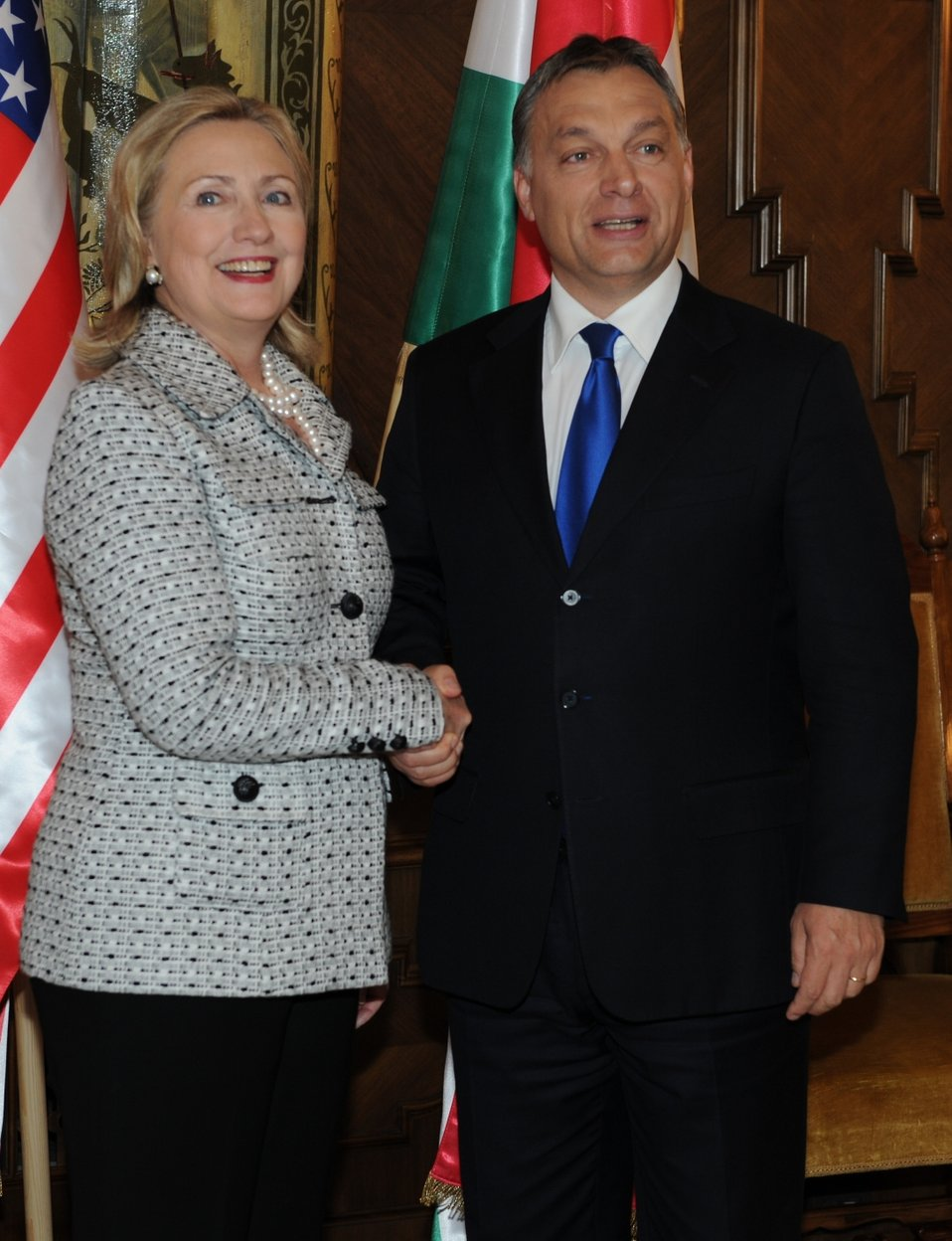 Secretary Clinton and Hungarian Prime Minister Orban Shake Hands