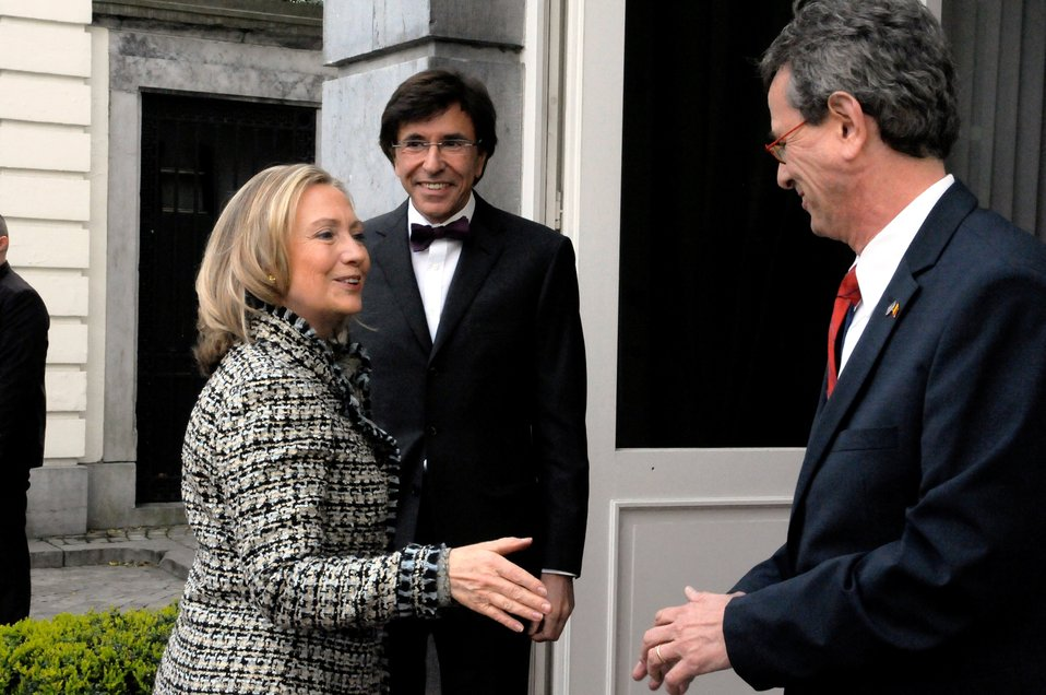 Secretary Clinton Is Greeted By Ambassador Gutman and Belgian Prime Minister Di Rupo