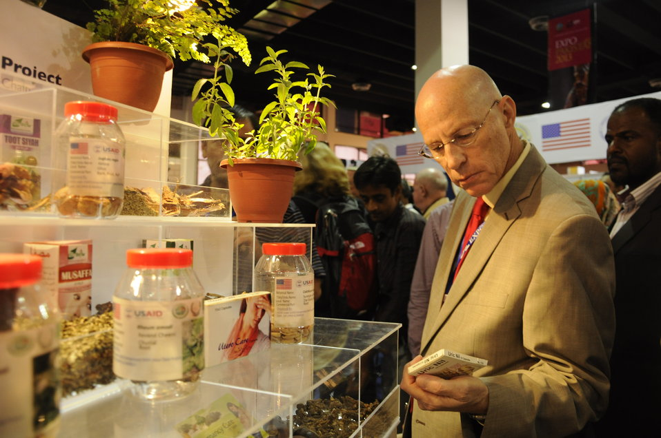 Gregory Gottlieb, U.S. Agency for International Development's Mission Director for Pakistan, looking at Medicinal and Aromatic Plants at USAID's Entrepreneurs Project Stall