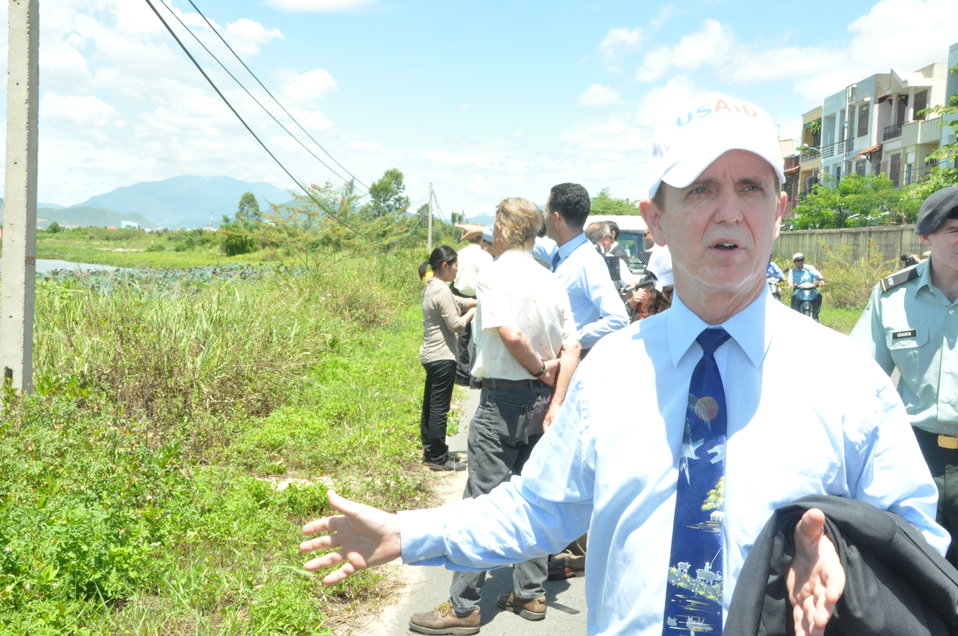 USAID Mission Director Francis Donovan explains the site at the Environmental Remediation of Dioxin Contamination at Danang Airport Project Launch