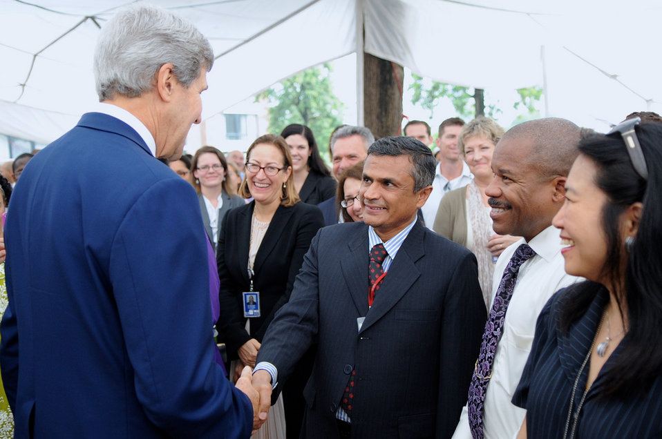 Secretary Kerry greets longtime Embassy Islamabad employee