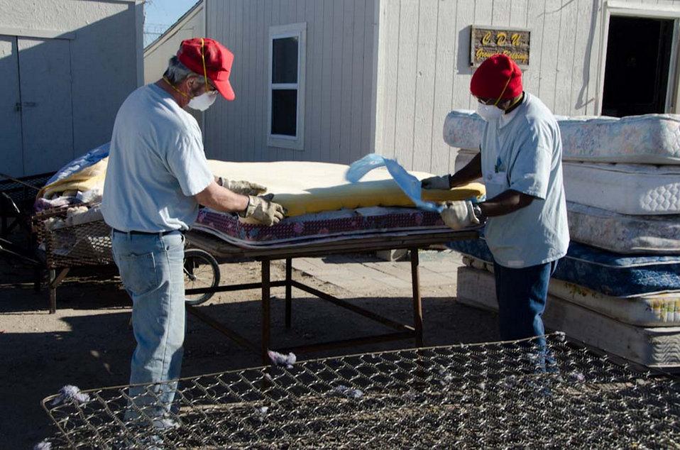 January 5, 2012 Inmates at the Hutchinson, Kan., Correctional Facility disassemble a mattress for recycling